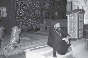 The Priest Abuna Pola Sitting on the Steps Leading to the Main Altar