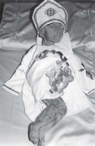 Mummy of a martyred child. Pamphlet of Dayr al-Shehada, 2006.