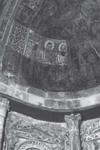 Test cleaning showing saints in the south semidome, sanctuary, Red Monastery Church. After Bolman 2004b (cover). Photograph: Patrick Godeau.