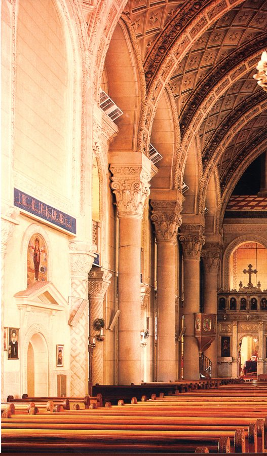 Interior view toward the sanctuary. The tan-rose section is the original church. The white section begins the later addition.