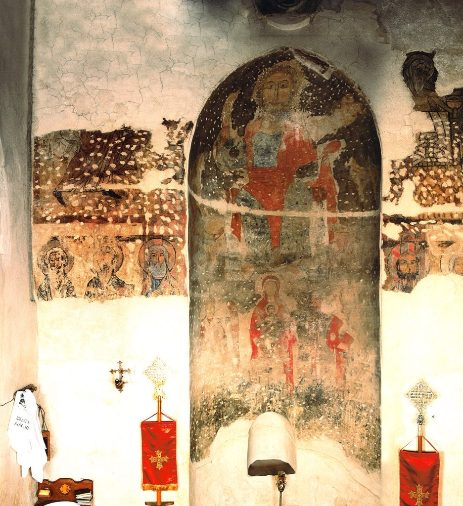 The east wall of the central altar room. In the niche, Christ enthroned and the Virgin with Child and archangels. To the left, the lower part of Abraham's Sacrifice; to the right the Meeting of Abraham and Melchizedek. Six apostles are painted below.