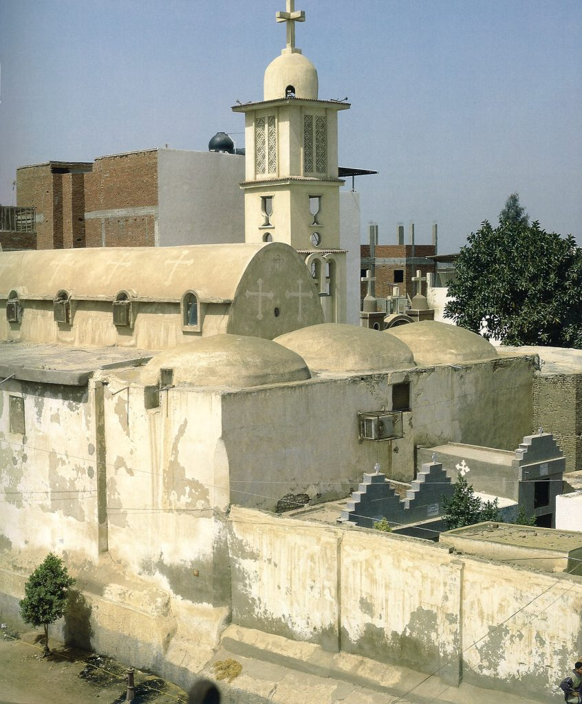 Exterior view with the belfry and domes.