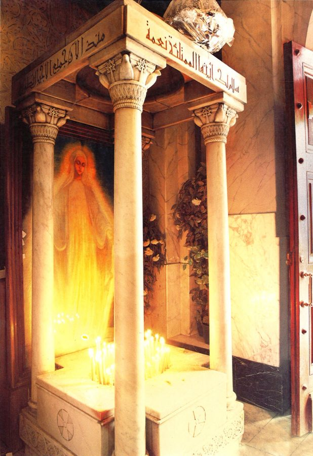 Shrine to the Virgin Mary with candles of the faithful