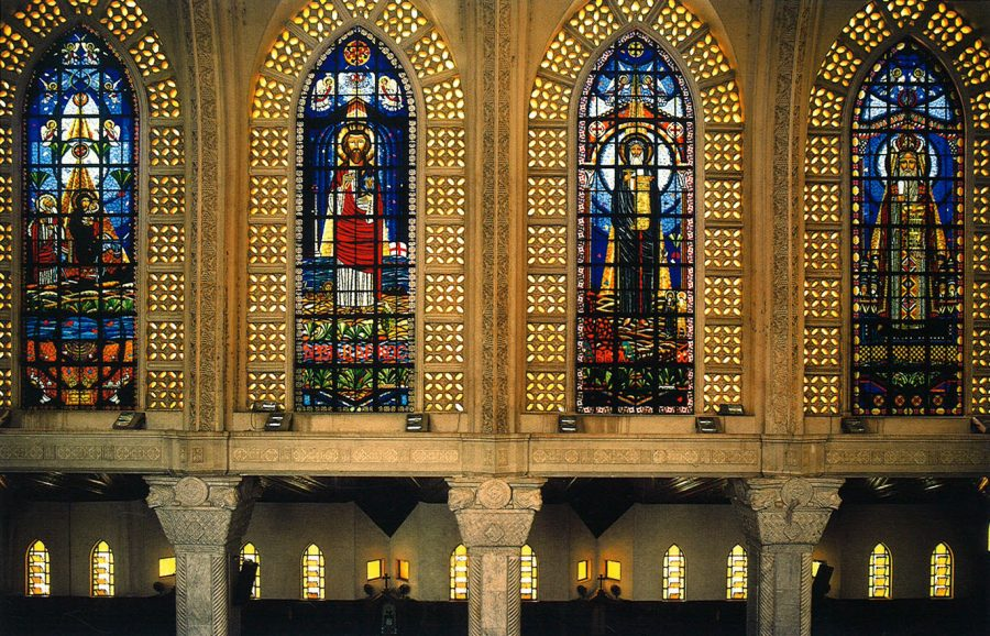 The Cathedral of St. Mark, southern side: stained glass windows decorated from left to right with the Flight into Egypt, St. Mark, St. Antony, and St. Athanasius.