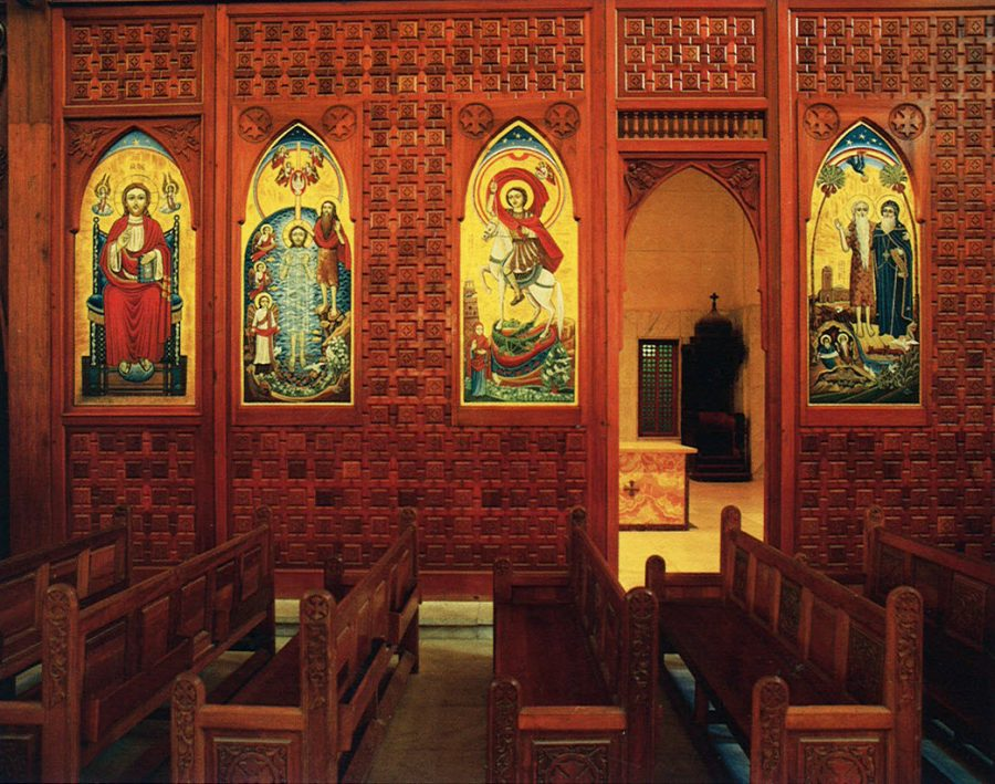 Part of the sanctuary's wooden screen decorated from left to right with the icons of Christ in Majesty, Baptism, St. George, and Sts. Paul and Antony.