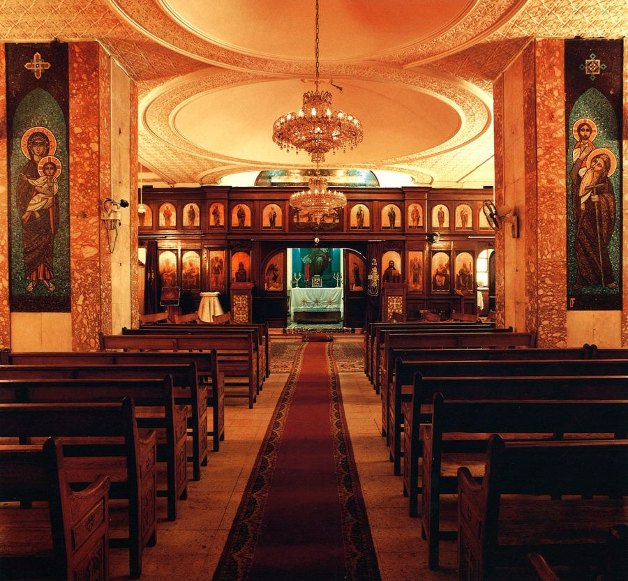 Church of the Holy Virgin Mary and St. Pshoi: interior view with the sanctuary and the two large mosaics.