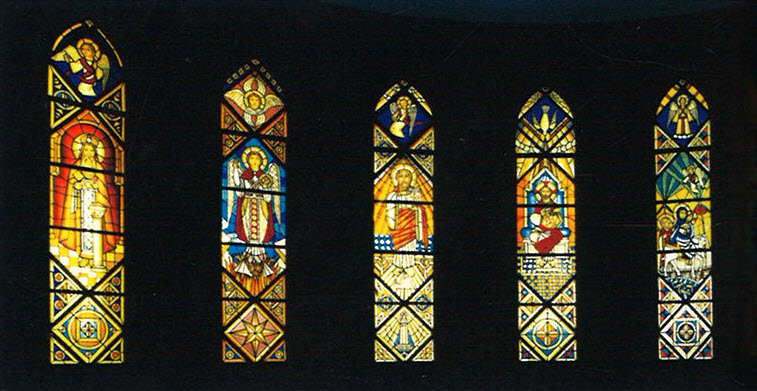 The Shrine of St. Mark: Stained-glass windows depicting Christ flanked by the Flight into Egypt and St. Mark the Evangelist.