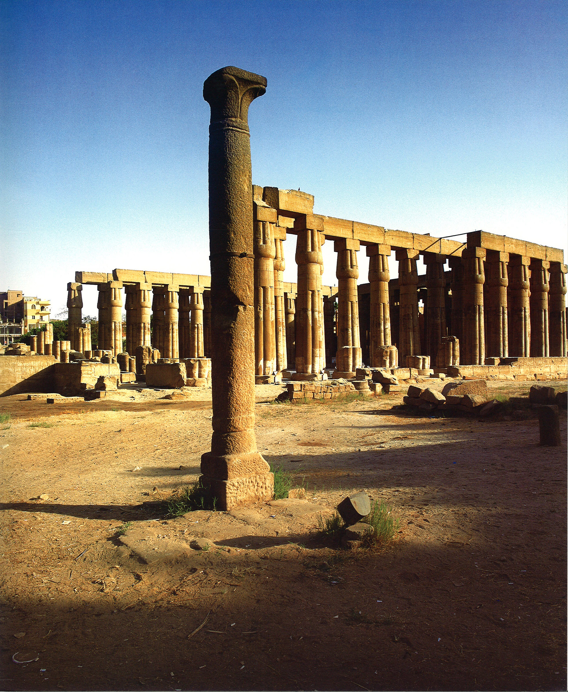 Column of the southwest church in Luxor Temple. In the background is the Forecourt of Amenhotep III.
